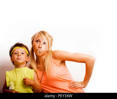 young pretty blong woman and little cute boy making bubble gum i - Stock Photo