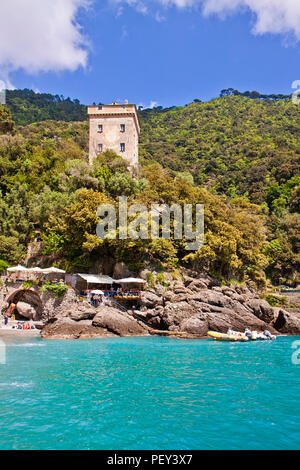 Liguria, Italy - the blue waters of San Fruttuoso bay near Genoa on the Tigullio gulf coast, a little piece of paradise accessible only by a pedestria - Stock Photo
