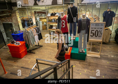 An Urban Outfitters retail store in Herald Square in New York on Thursday, August 9, 2018. Retailers are hoping that a revival of 90's fashions such as fanny packs, mom jeans and other retro looks will raise their bottom line in back-to-school sales. (© Richard B. Levine) - Stock Photo