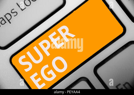 Writing note showing Super Ego. Business photo showcasing The I or self of any person that is empowering his whole soul Keyboard orange key Intention  - Stock Photo
