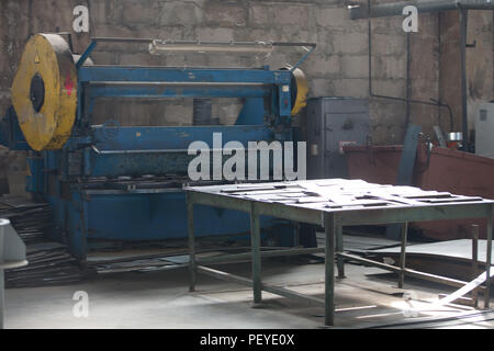 The old machine in the Russian factory for metal cutting - Stock Photo