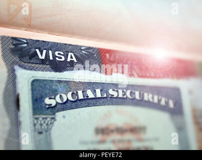 The American visa in a blurred passport page background and social security number personal document. SSN – social security number for live in USA - s - Stock Photo