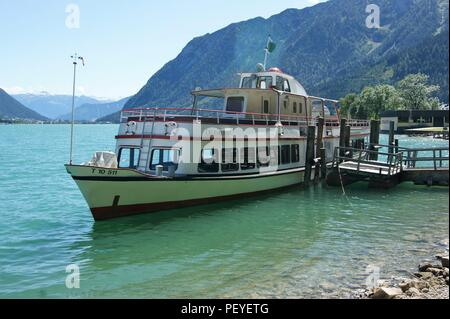Lake ferry St.Benedikt arrives at Pertisau landing stage, Austria - Stock Photo