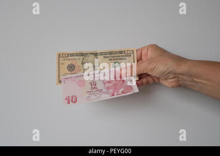 American dollar and Turkish Lira side by side - Stock Photo