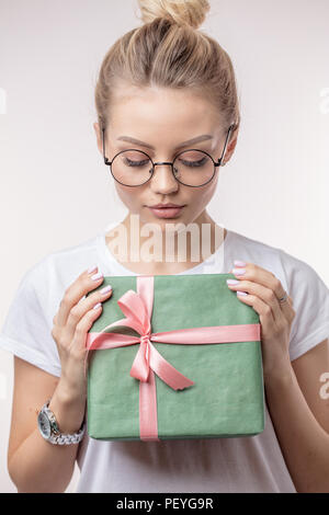 beautiful woman is looking at the gift from Santa Clause. event concept. - Stock Photo