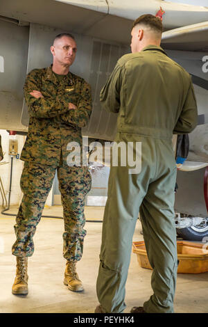 Lt. Col. Shannon M. Brown, right, briefs Maj. Gen. Gary L. Thomas during a visit to Marine Corps Air Station Beaufort Feb. 17, 2016. Thomas visited various squadrons to observe their operations and interact with the Marines from each unit while at the air station. Thomas is the commanding general of 2nd Marine Aircraft Wing and Brown is the commanding officer of Marine Fighter Attack Squadron 115, Marine Aircraft Group 31. Stock Photo