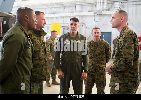 Maj. Gen. Gary Thomas speaks to Marines about their day-to-day operations during a visit to Marine Corps Air Station Beaufort Feb. 17, 2016. Thomas visited various squadrons to observe their operations and interact with the Marines from each unit while at the air station. Thomas is the commanding general of 2nd Marine Aircraft Wing and the Marines are with Marine Fighter Attack Squadron 115, Marine Aircraft Group 31. Stock Photo