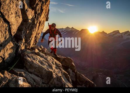 A climber on the Hornli Ridge of the Matterhorn - Stock Photo