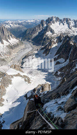 A climber on the Dent du Geant - Stock Photo