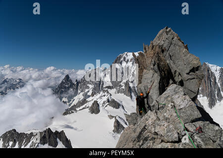 A climber on the Dent du Geant - Stock Photo