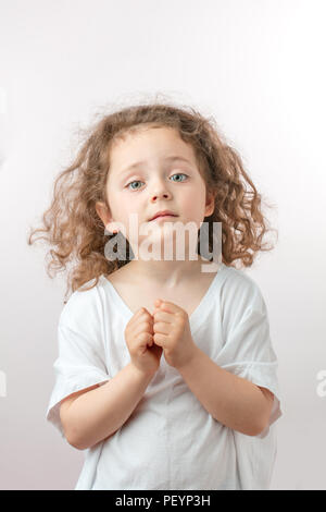kind beautiful ginger girl is begging like an angel. kid asks help. innocense concept - Stock Photo