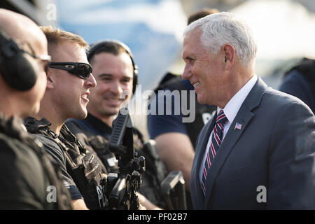 Vice President Mike Pence greets members of law enforcement prior to boarding Air Force Two at Toledo Express Airport in Swanton, Ohio Tuesday, August 14, 2018, en route to Joint Base Andrews, Md  People:  Vice President Mike Pence - Stock Photo