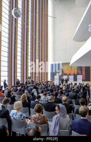 United Nations. 17th Aug, 2018. People attend the opening ceremony of a multimedia exhibition: 'Surviving Terrorism: Victims' Voices' at the UN headquarters in New York, Aug. 17, 2018. UN Secretary-General Antonio Guterres said Friday that supporting victims and their families of terror attacks is 'a moral imperative' based on promoting, protecting and respecting their human rights. Credit: Li Muzi/Xinhua/Alamy Live News - Stock Photo
