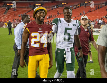 Washington Redskins defensive back Josh Norman (24) and New York Jets quarterback Teddy Bridgewater (5) leave the field together following the game at FedEx Field in Landover, Maryland on Thursday, August 16, 2018. The Redskins won the game 15 - 13. Credit: Ron Sachs/CNP (RESTRICTION: NO New York or New Jersey Newspapers or newspapers within a 75 mile radius of New York City)   usage worldwide Credit: dpa picture alliance/Alamy Live News - Stock Photo