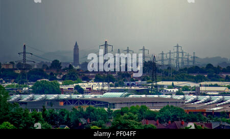 Glasgow, Scotland, UK. 18th August, 2018. UK Weather:Black and gray sky as storm Ernesto is due over the town as overnight rain is forcasted through the day.No sky colour with  any sense of perspective comes from the city's buildings as the sun fails to appear overhead. The electrical pylons of Braehead towering with the now defunct water tower of the old levendale hospital to the modern Intu shopping centre on the banks of the clyde river near renfrew; Gerard Ferry/Alamy news Credit: gerard ferry/Alamy Live News - Stock Photo