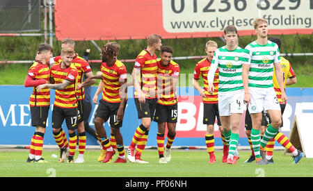 Firhill Stadium, Glasgow, UK. 18th Aug, 2018. Scottish League Cup football, second round, Partick Thistle versus Celtic; Partick Thistle players celebrate their equaliser with Andrea Mbuyi-Mutombo Credit: Action Plus Sports/Alamy Live News - Stock Photo