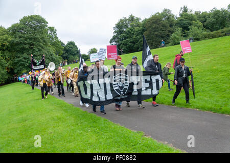 Glasgow, Scotland, UK. 18th August, 2018. A banner saying United Glasgow is carried in the parade of the Govanhill International Festival & Carnival. This year's parade includes community groups, a pipe band, drummers, dancers, jugglers, roller skaters and a brass band all starting at Govanhill Park and travelling through the streets of Govanhill finishing at the Queen's Park Arena. Credit: Skully/Alamy Live News - Stock Photo