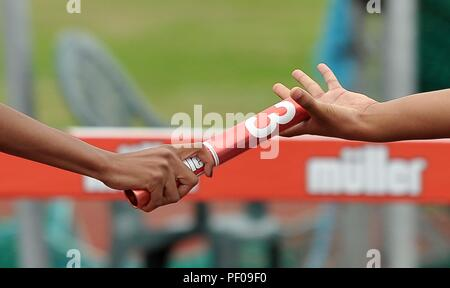 Birmingham, UK. 18th August 2018. Handing over the baton. Relay race. Muller Grand Prix Birmingham. Diamond league. Alexander Stadium. Perry Bar. Birmingham. UK. 18/08/2018. Credit: Sport In Pictures/Alamy Live News - Stock Photo