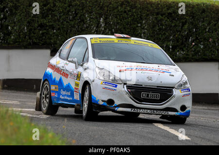 County Antrim, Northern Ireland. 18th Aug, 2018. John Mulholland Motors Ulster Rally; Norwegain driver Steve Rokland and co-driver Dai Roberts (Peugeot 208 R2) finish 2nd in Class A4, and 11th overall Credit: Action Plus Sports/Alamy Live News - Stock Photo