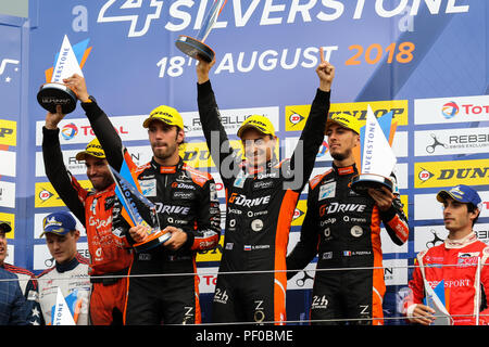Jean-Eric Vergne, Roman Rusinov and Andrea Pizzitola, drivers of the #26 G-Drive Racing Oreca 07 Gibson, celebrate winning in the European Le Mans Series round at Silverstone - Stock Photo