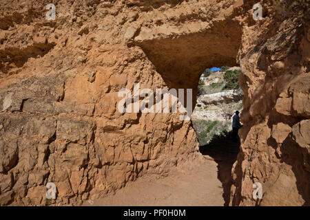 AZ00297-00...ARIZONA - Tunnel through a rock rib near the top of the Bright Angel Trail in Grand Canyon National Park. - Stock Photo