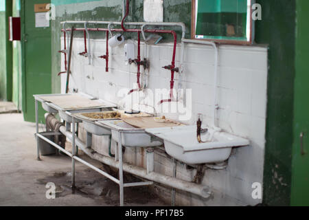 Old washbasins in the factory - Stock Photo