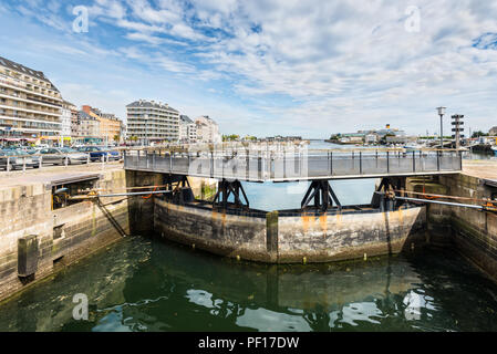 Cherbourg-Octeville, France - May 22, 2017: Dam and bridge over the canal (the lock of the harbor) in Cherbourg-Octeville, Normandy, France. - Stock Photo
