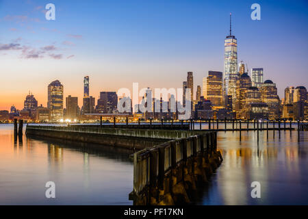 Downtown New York and Lower Manhattan as seen from the Jersey City side of the Hudson River. - Stock Photo