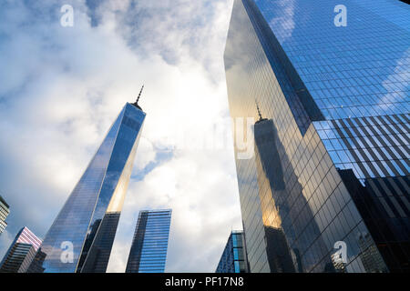 One WTC reflected in the glass curtain wall of Four WTC in Lower Manhattan, New York City. - Stock Photo