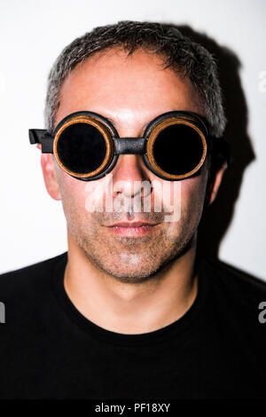 Man in steampunk glasseses on white background - Stock Photo