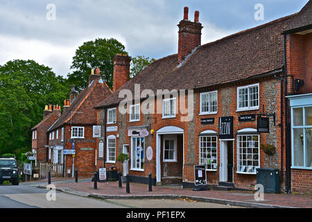 A pretty row of traditional shops and offices in a terraced building on the side of the main road through the village of Botley, Southampton,Hampshire - Stock Photo