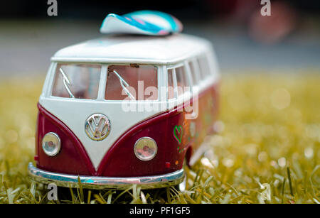 Model of a VW Volkswagen Camper Van with Surfboard, The Type T2 Split Screen was first introduced in 1950 - Stock Photo