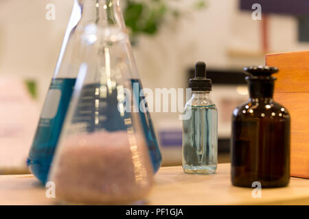 Transparent glass bottles filled liquid - Stock Photo