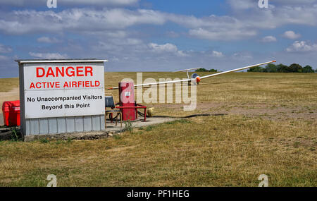 Glider on airfield in The Cotswolds United Kingdom - Stock Photo