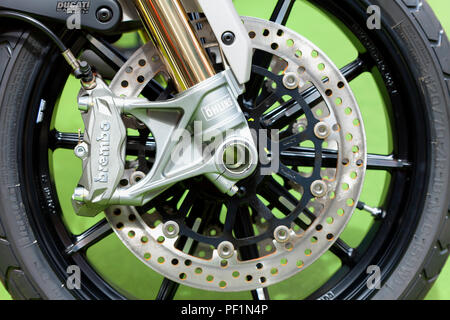 Brembo brake system with ventilated discs. Here they are installed on a Ducati motorcycle. - Stock Photo
