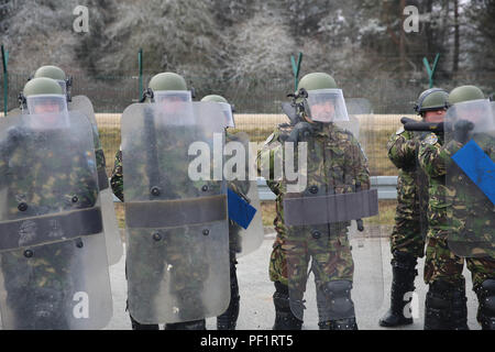 Romanian soldiers of 26th Mountain Battalion conduct crowd riot control training while conducting a riot control exercise during a Kosovo Force (KFOR) mission rehearsal exercise (MRE) at the Joint Multinational Readiness Center in Hohenfels, Germany, Feb. 18, 2016. The KFOR MRE 21 is based on the current operational environment and is designed to prepare the unit for peace support, stability, and contingency operations in Kosovo in support of civil authorities to maintain a safe and secure environment.  (U.S. Army photo by Pvt. Randy Wren/Released) - Stock Photo