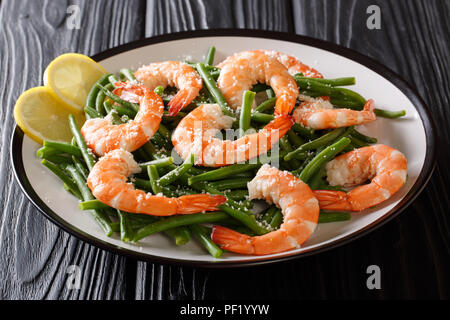 Organic food, salad: shrimps with green beans, cheese and lemon close-up on a plate on a table. horizontal - Stock Photo