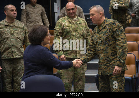 U.S. Marine Lt. Gen. John E. Wissler, Commanding General, III Marine Expeditionary Force, shakes hands with Georgian Minister of Defense Tina Khidasheli while on a visit to the Joint Multinational Readiness Center (JMRC) during a mission rehearsal exercise (MRE) at JMRC in Hohenfels, Germany, Feb. 24, 2016. The 52nd Georgian Light Infantry Battalion prepares for an upcoming combat deployment to Afghanistan by conducting a MRE supported by the U.S. Marine Corps Security Cooperation Group in Hohenfels, Germany, Feb. 7 - March 3, 2016. The Georgia Deployment Program - Resolute Support Mission, fo - Stock Photo