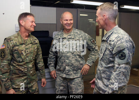 U.S. Army Reserve Brig Gen. Carlton Fisher, deputy chief of chaplains, U.S. Army Reserve Command, left, shares a laugh with Col. David Vanderjagt, garrison chaplain, Fort Knox, Ky., and Sgt. Maj. Dwayne Riden, chief chaplain assistant, 84th Training Command, Fort Knox, during the Command's Unit Ministry Team Workshop on Fort Knox Feb. 17, 2016. (U.S. Army Photo by Clinton Wood/Released) - Stock Photo
