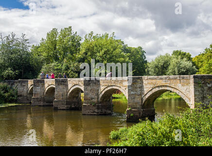 Essex Bridge, a footpath and packhorse bridge built in the 16th Century, crossing over the River Trent near Shugborough Estate. - Stock Photo