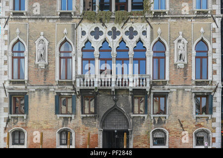 Facade of palace Loredan dell'Ambasciatore on Grand Canal in Venice city in spring. Palazzo Loredan dell'Ambasciatore is a late 15th-century Gothic pa - Stock Photo