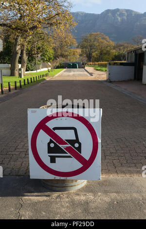 road sign or signage in road showing cars are not allowed to enter - Stock Photo