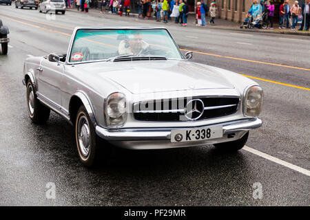 MERCEDES-BENZ 230SL,silver, 1964 model, 2 seats. Classic cars parading through the port area in Bergn, Norway. Fjordsteam 2018,. - Stock Photo