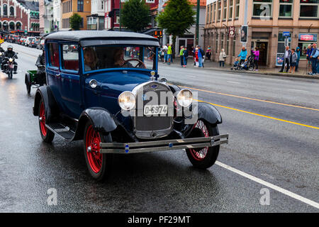 Ford Sedan, 1928 model, blue, five seats. Classic cars parading through the port area in Bergn, Norway. Fjordsteam 2018,. - Stock Photo