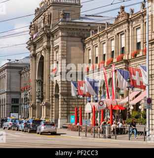 Zurich, Switzerland - September 27, 2017: building of the Zurich main railway station, people and taxi cars at it. The Zurich main railway station is  - Stock Photo