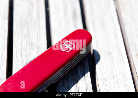 Victorinox swiss army knife red wood - Stock Photo