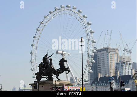 Sculpture of the queen Boadicea and her daughters in a chariot with the London Eye ferris wheel in the distance, London, England, UK - Stock Photo