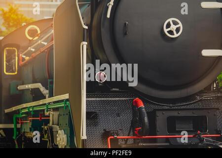 Close up antique vintage train locomotive. Old steam engine locomotive. Black locomotive. History industry. Historic steam train. Old transportation v - Stock Photo