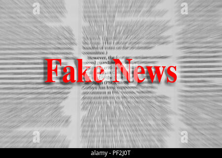 Fake news written in red with a newspaper article blurred in the background - Stock Photo