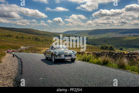 The yearly Yorkshire Pudding MG and Classic Car Run saw 160 cars driving the trip around God's Own County with roofs down on another spectacular summe - Stock Photo